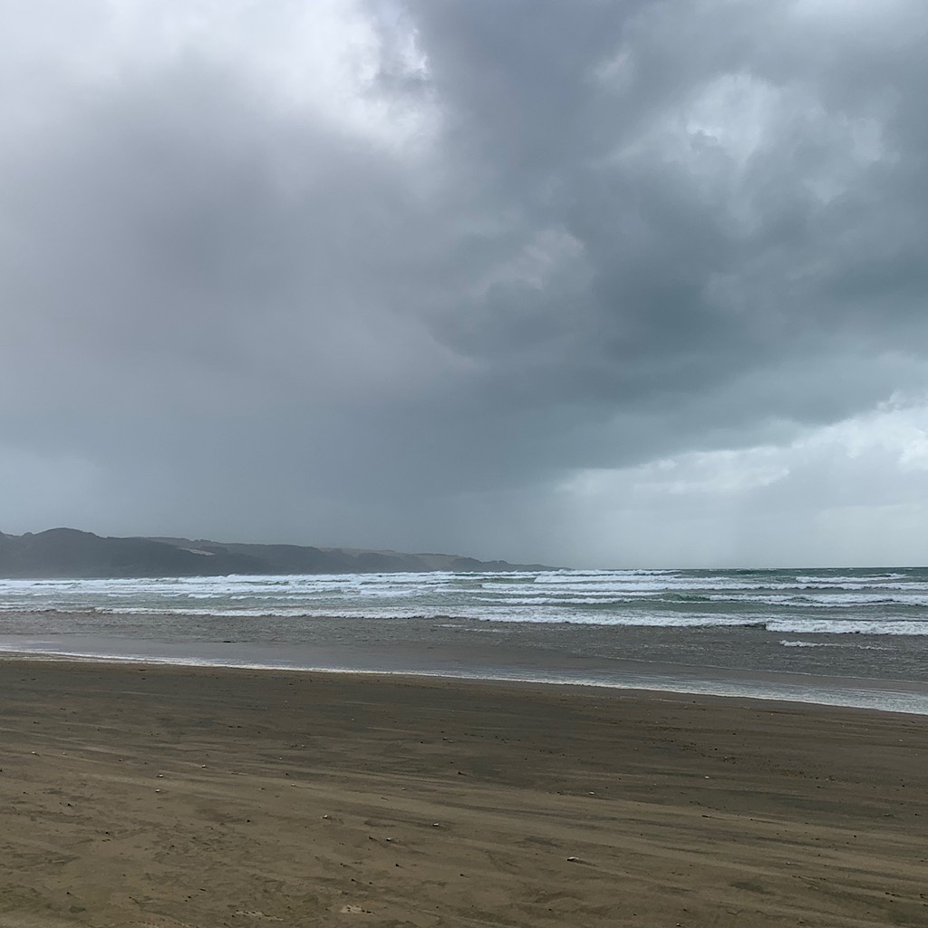 Ahipara is getting closer and the end of the beach as a squall approaches.