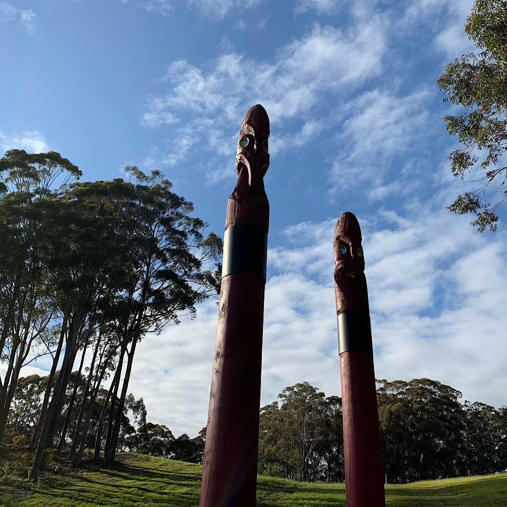 "A Māori pou whenua or ""land post"" that marks territory and tells a story, much like totem poles."