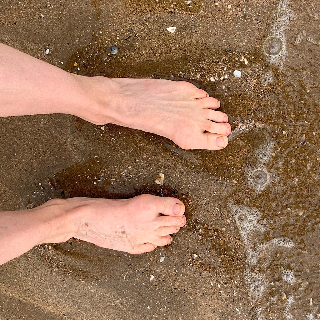 The Pacific Ocean feels glorious on my tired feet.