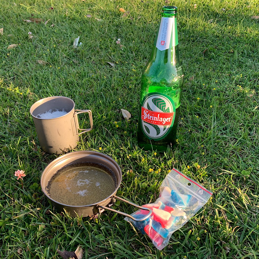 I brought gummies to settle up with Bram from the other night when he gave me all of his,  and he brought Steinlager to share at the beautiful camp spot in Whananaki.