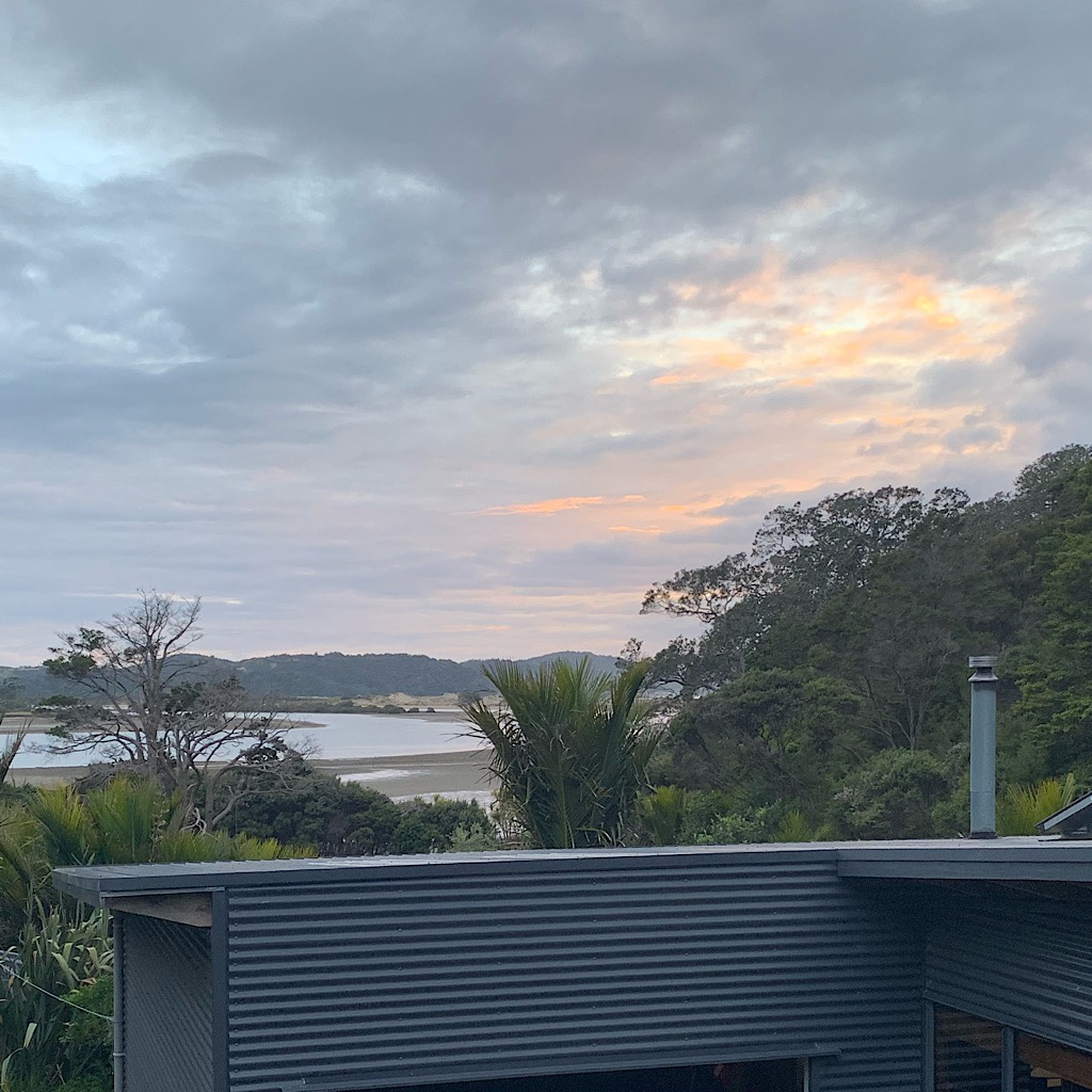 The view from my single room out above James private residence towards Nikau Bay.