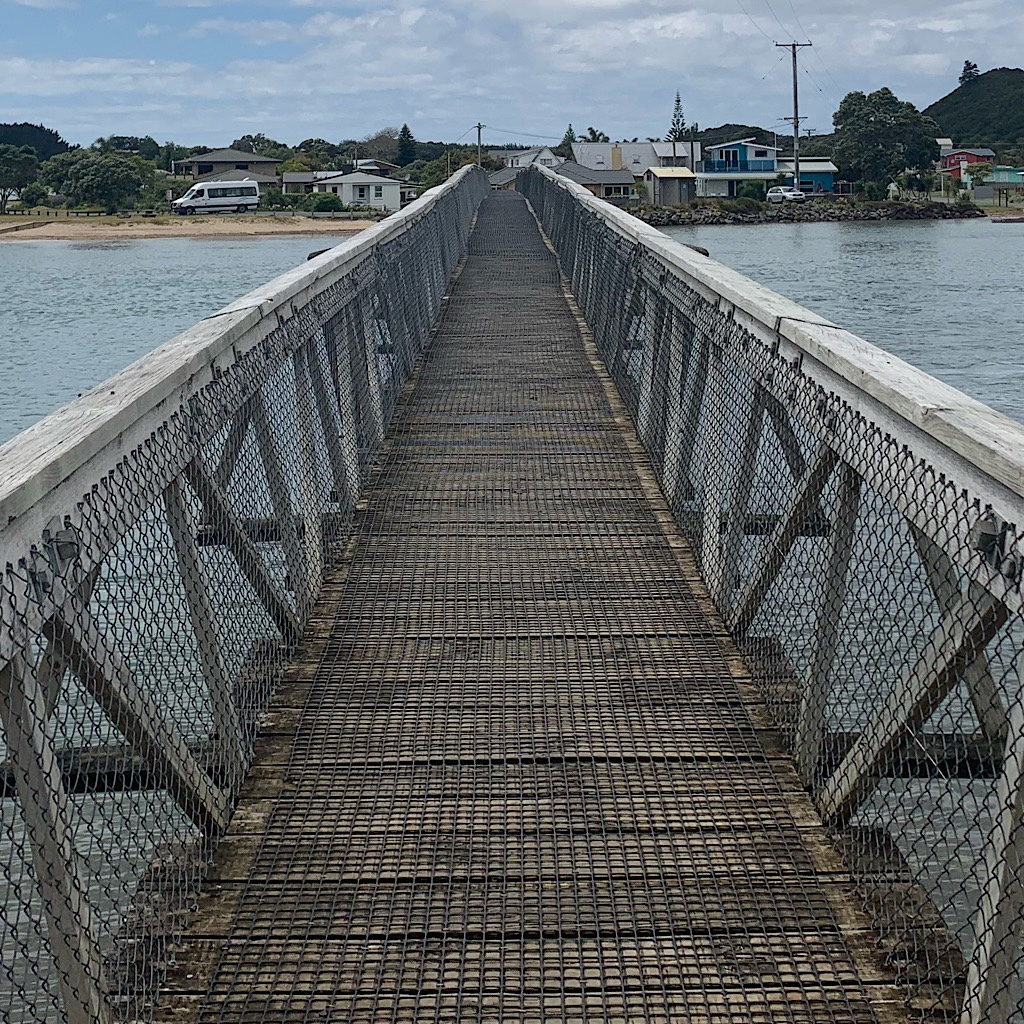The footbridge to the Pataua North settlement.