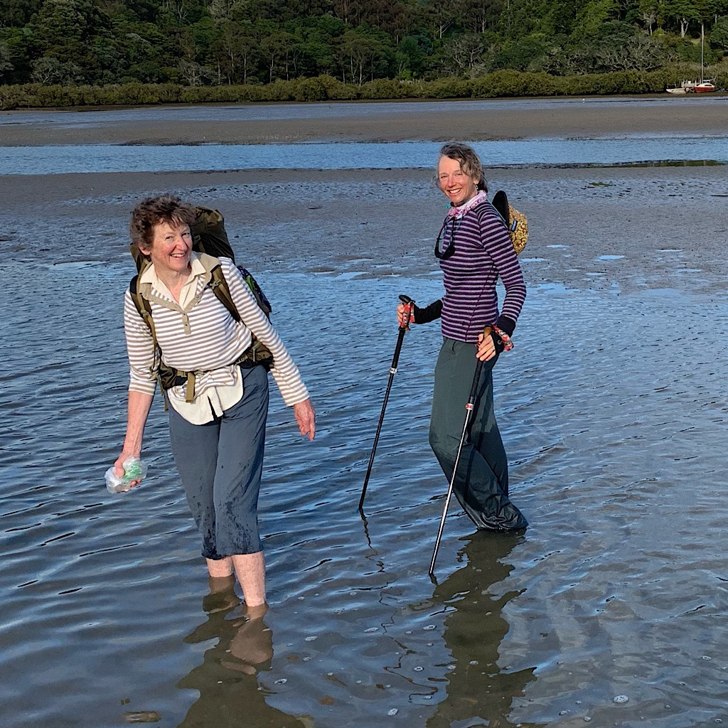 Ros hiked the Te Araroa last year at the age of 66. This morning, she carries Olive Oyl across the Taiharuru Estuary.