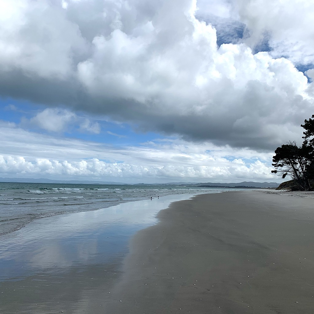 "The glorious beach near Ruakaka and clouds that must have looked the same when the islands were named Aotearoa, or ""Land of the Lpng White Cloud."""