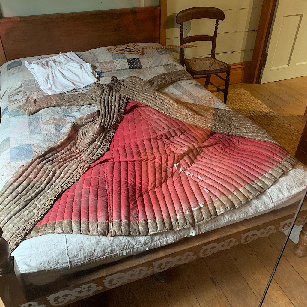 An early example of goose down sewn into baffles in a 19th century coat at the historic Acacia Cottage.