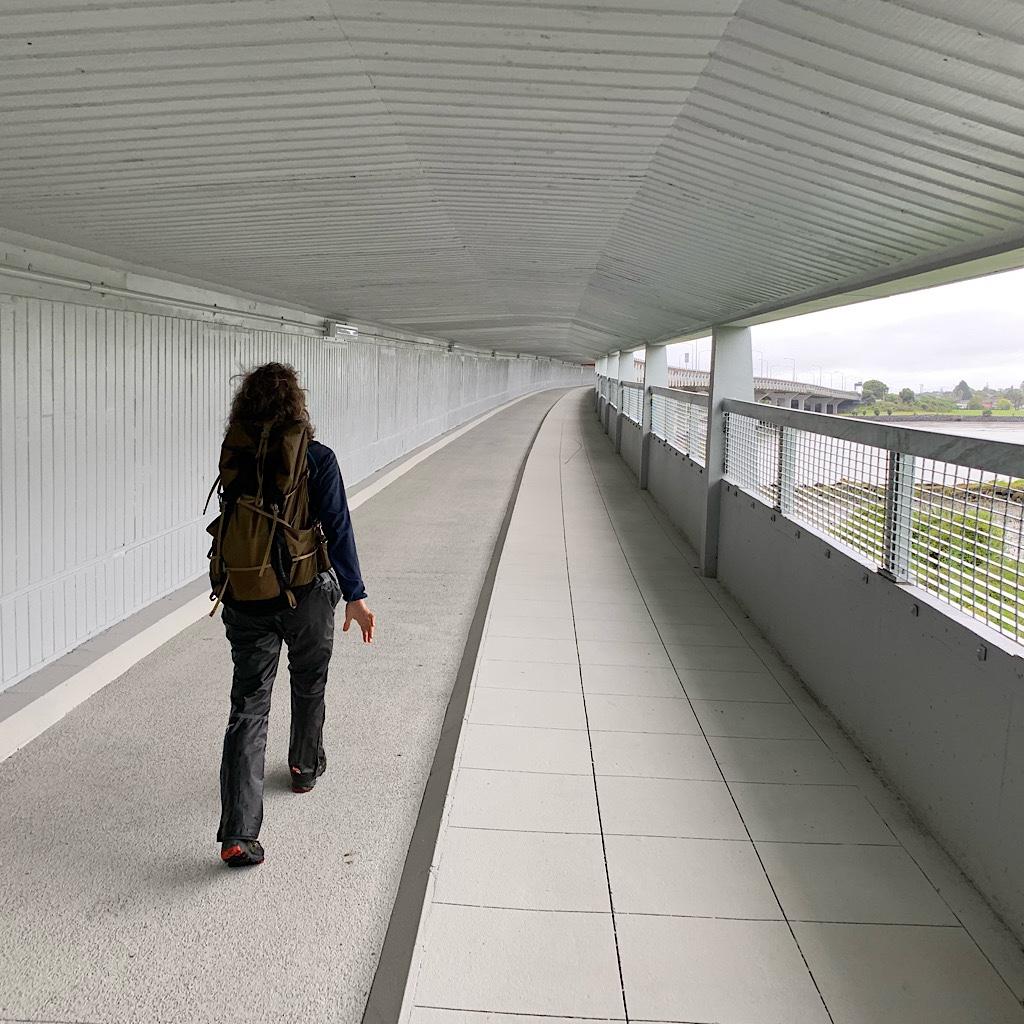 "I walk fast across the pedestrian bridge over Manukau Bay named ""muggers alley."""