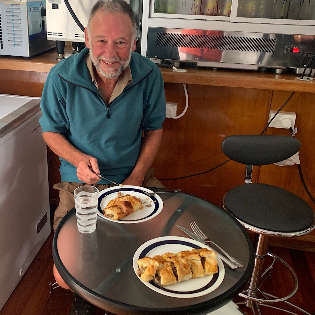 A fellow Kiwi thru-hiker and i share out delicious meat pie at breakfast before setting off.
