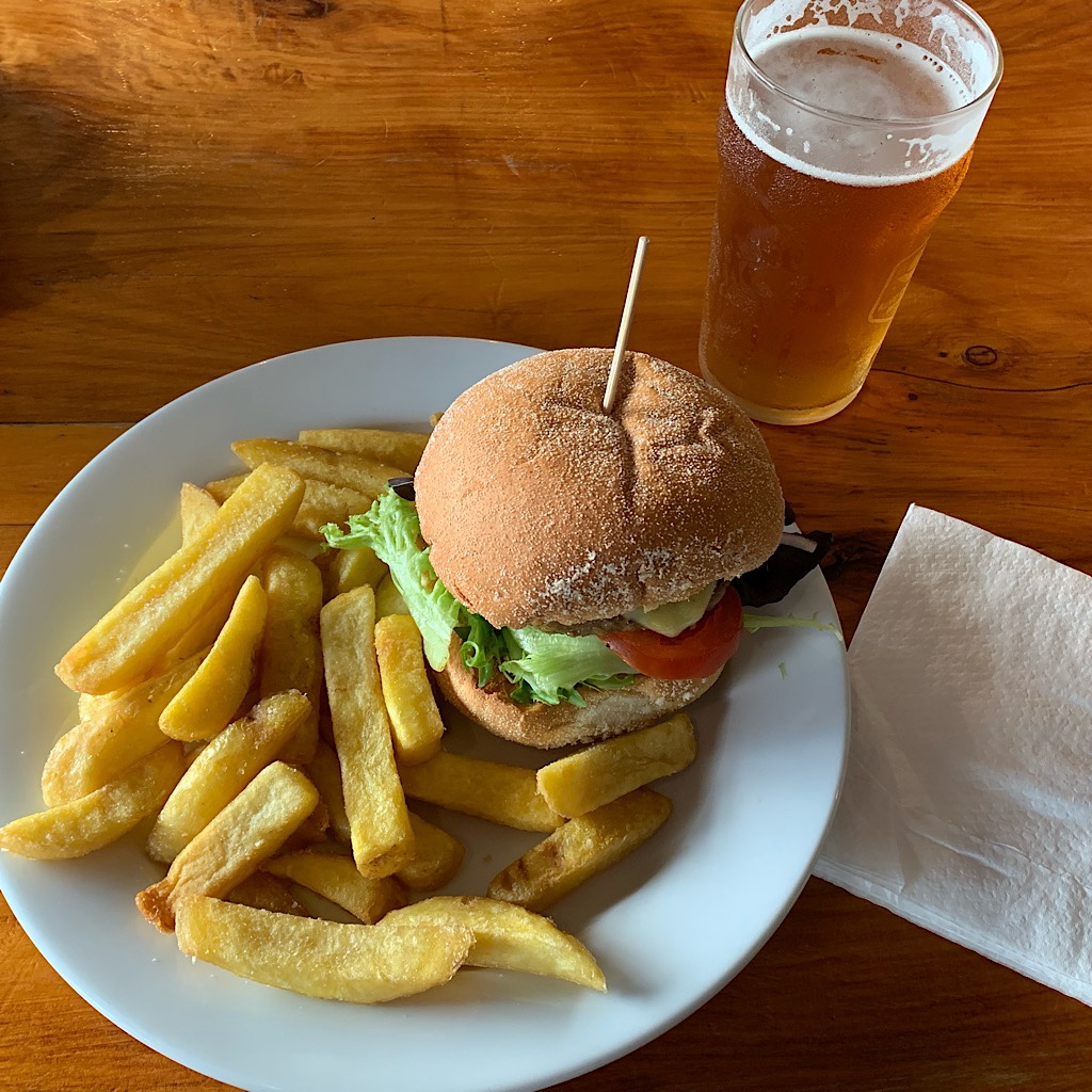 A hamburger and local brew at Curly's Bar in Waitomo.