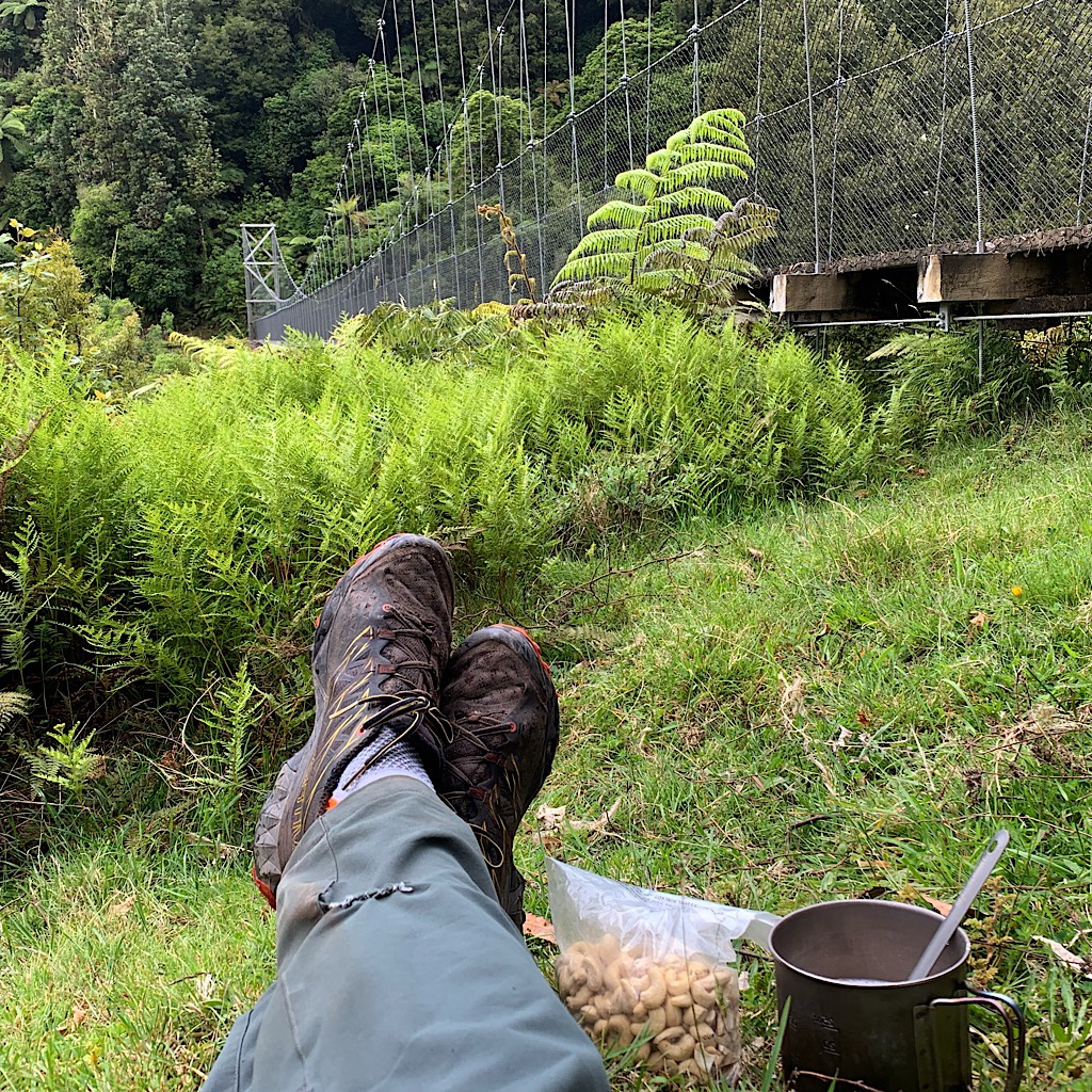 A snack next to Mangatukutuku, one of the eight suspension bridges on the Timber Trail.
