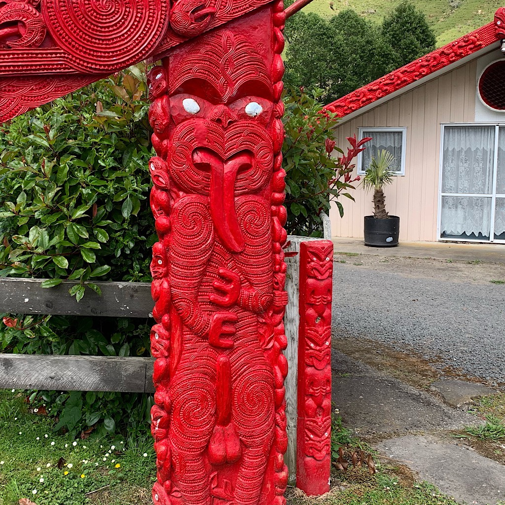 A Toi whakairo – or art carving – at the local Marae of a well endowed creature in the traditional haka pose.