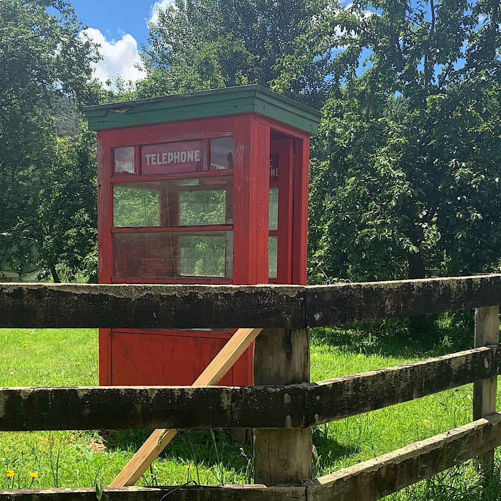 No longer in use but simply a curiosity, this red phone booth sits in a farmer's field.