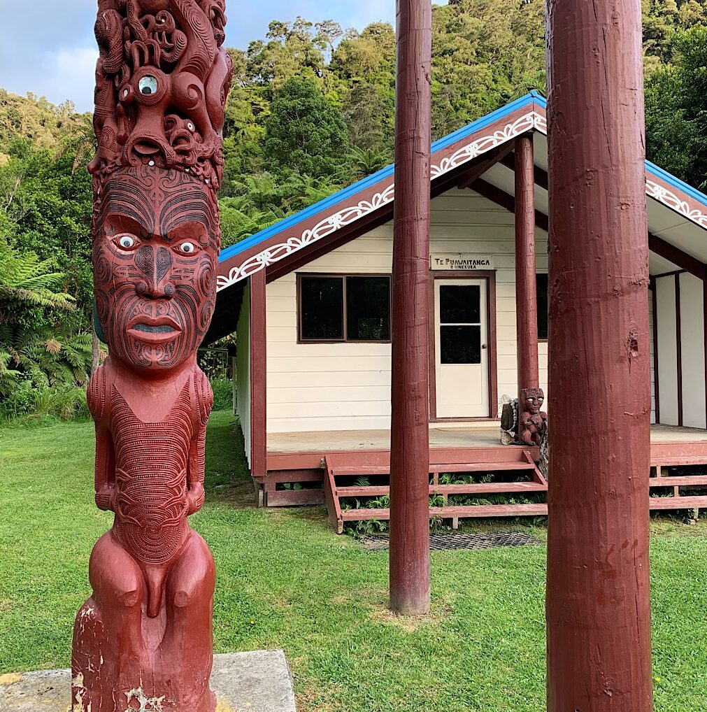 The marae at Tieke Kainga converted from a tramping hut after the Maori won their land claim. They kept the blue roof as symbol of DOC's tarps used during the dispute.