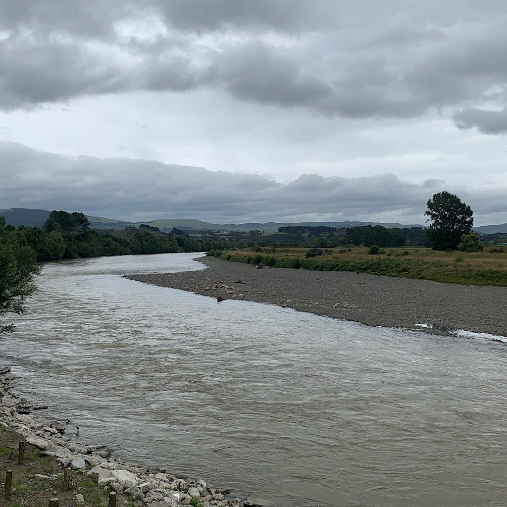 The Manawatu River which drains the Ruahine range to the northwest and runs through Palmerston North.