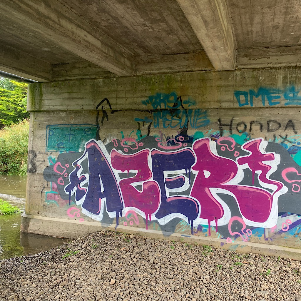 Colorful tags under the bridge. The day was so grim and it was a holiday, I saw absolutely no one all day.