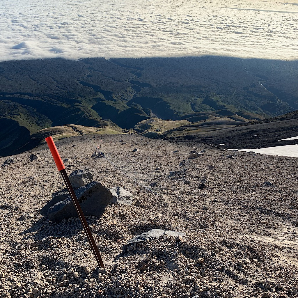 The scree slope was smooth with tiny ball-bearing stones. It was much easier to climb up than descend.