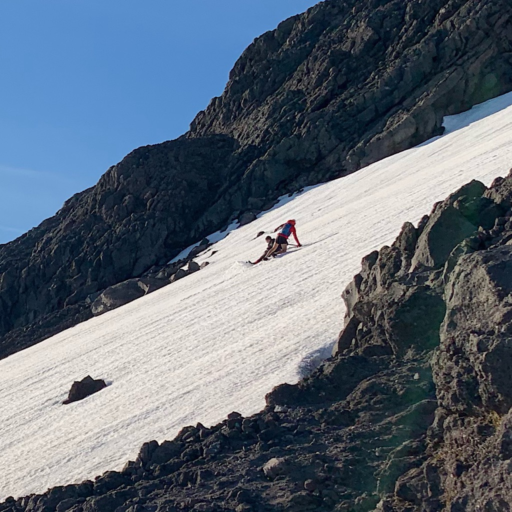 We shared the summit with two locals who slid down the snow pack rather than risk a brutal fall on the scree.