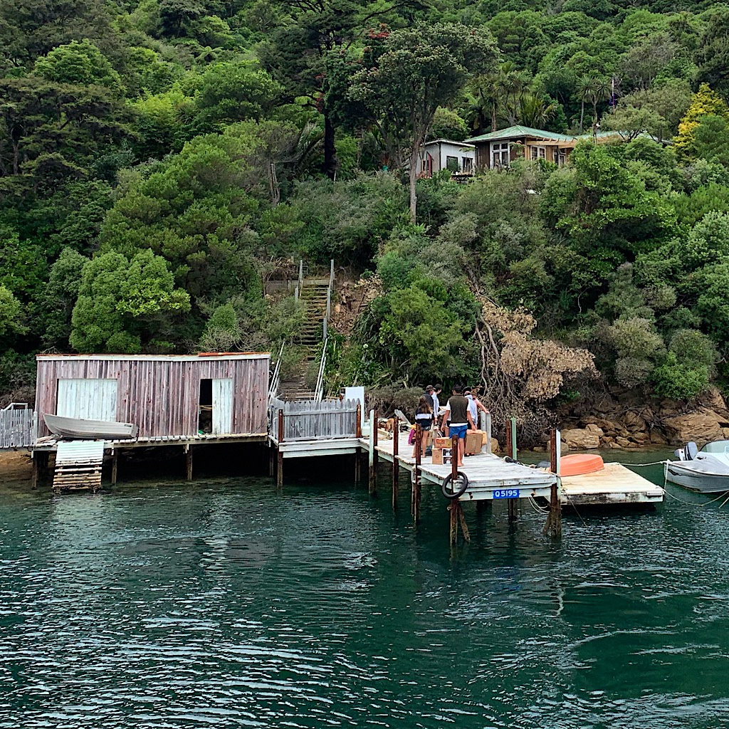 Delivering mail and goods to one of the many secluded houses in the Sound. The captain shared the cost of nearly every property as we passed through.