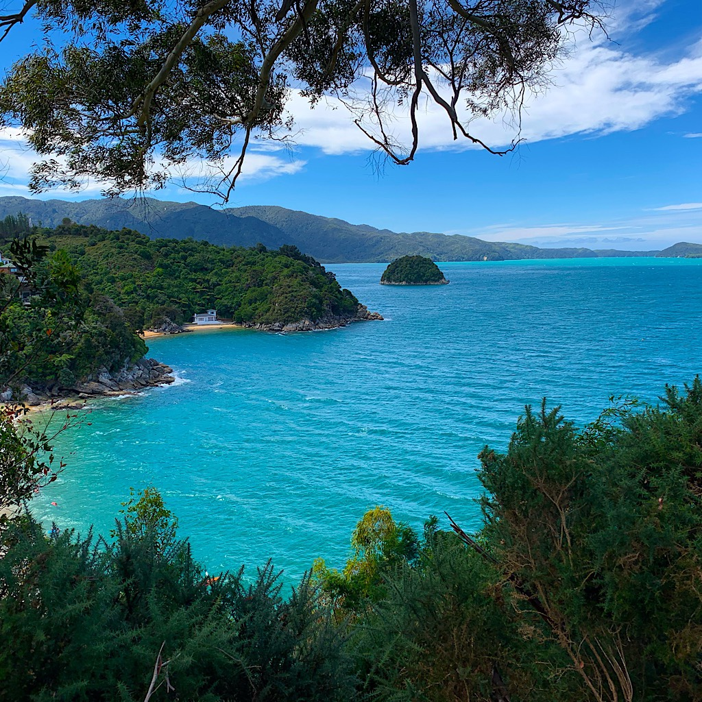 The mountains seems to grow out of the aquamarine water and golden sand of Abel Tasman park.
