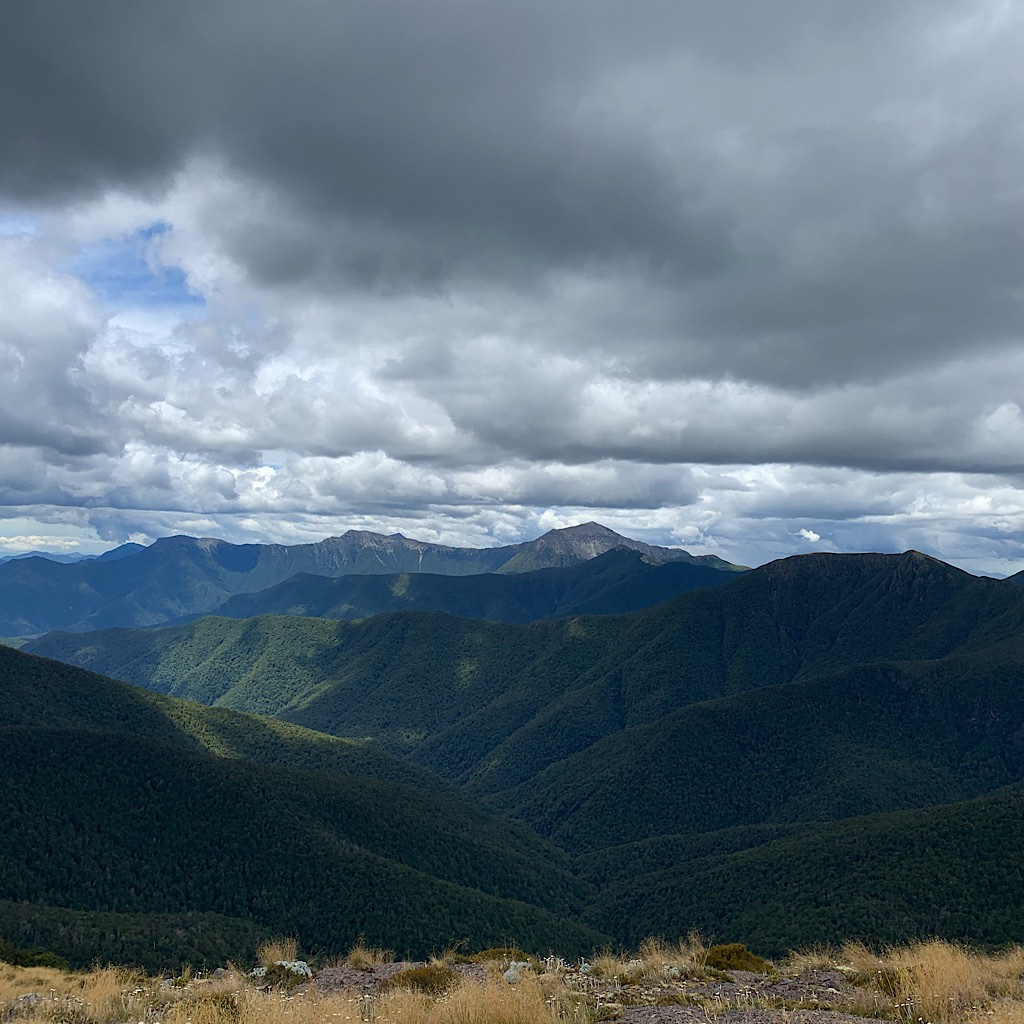 The ridge near Slaty hut with clouds so low, it feels like I can touch them.