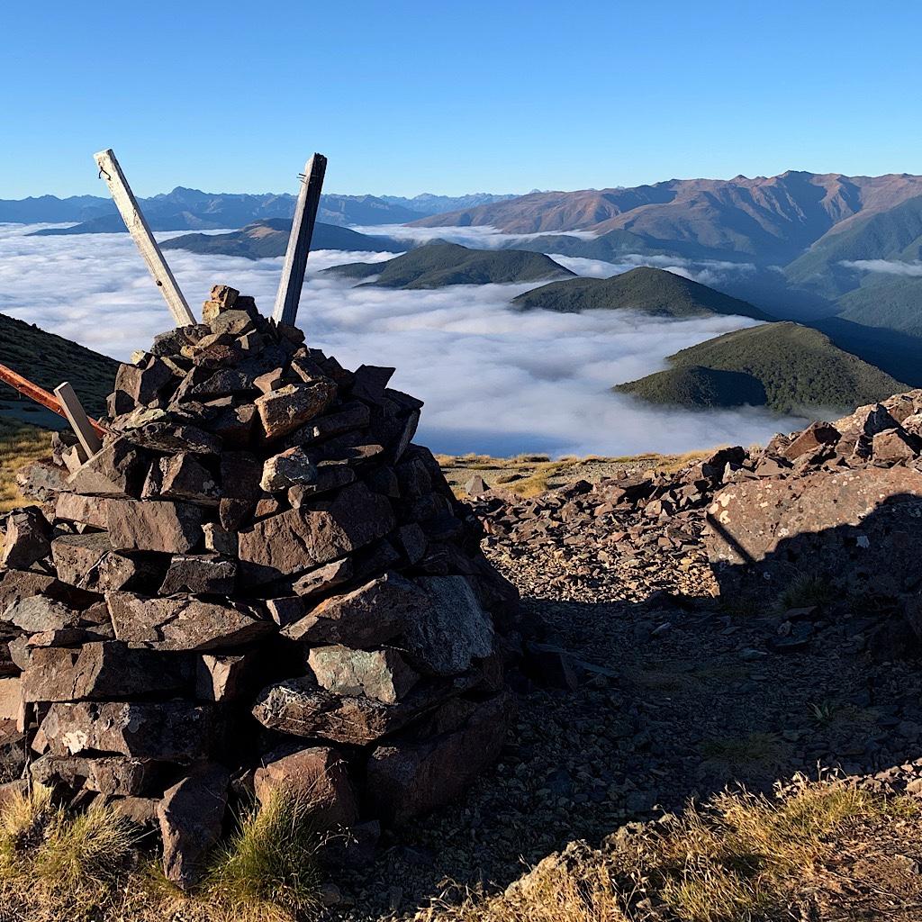 Clouds like a blanket below the summit.