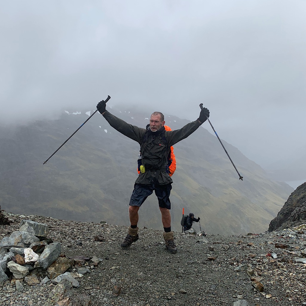 Russell thrilled to reach the top of Waiau Pass. We had views all day except from this one spot.