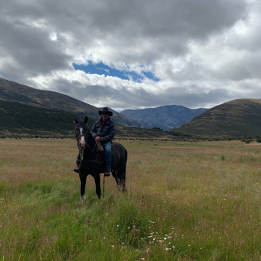 The New Zealand cowboy who told us we needed to hide in the trees until the wild horses came by.