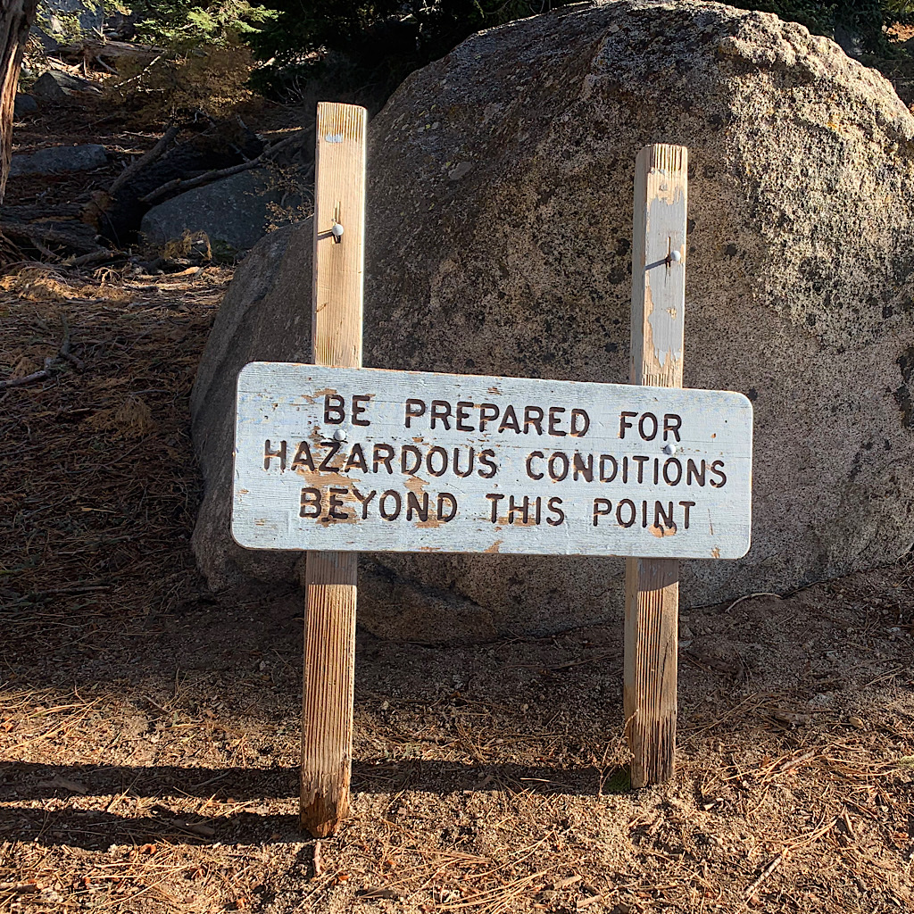 The sign warns of potential hazard as the trail leads above tree line on San Jacinto Peak.