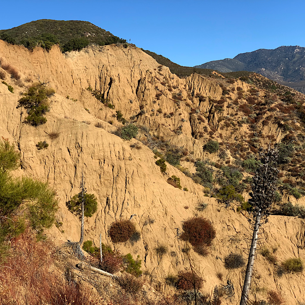 """The PCT passes by a """"badlands"""" of eroding mountainside."""
