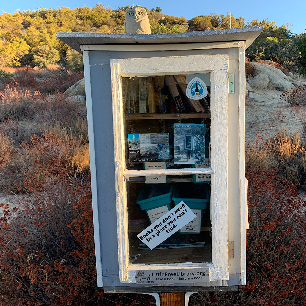 "A little free library with literary gems, some in minuscule ""ultralite hiker"" font."