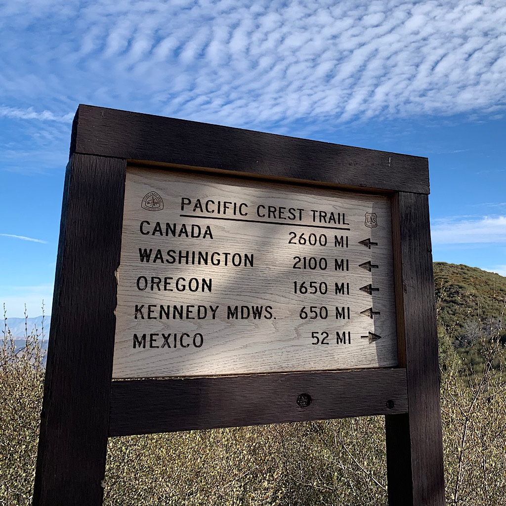 A sign shows me I how far I've come and how far I have to go to finish the PCT.