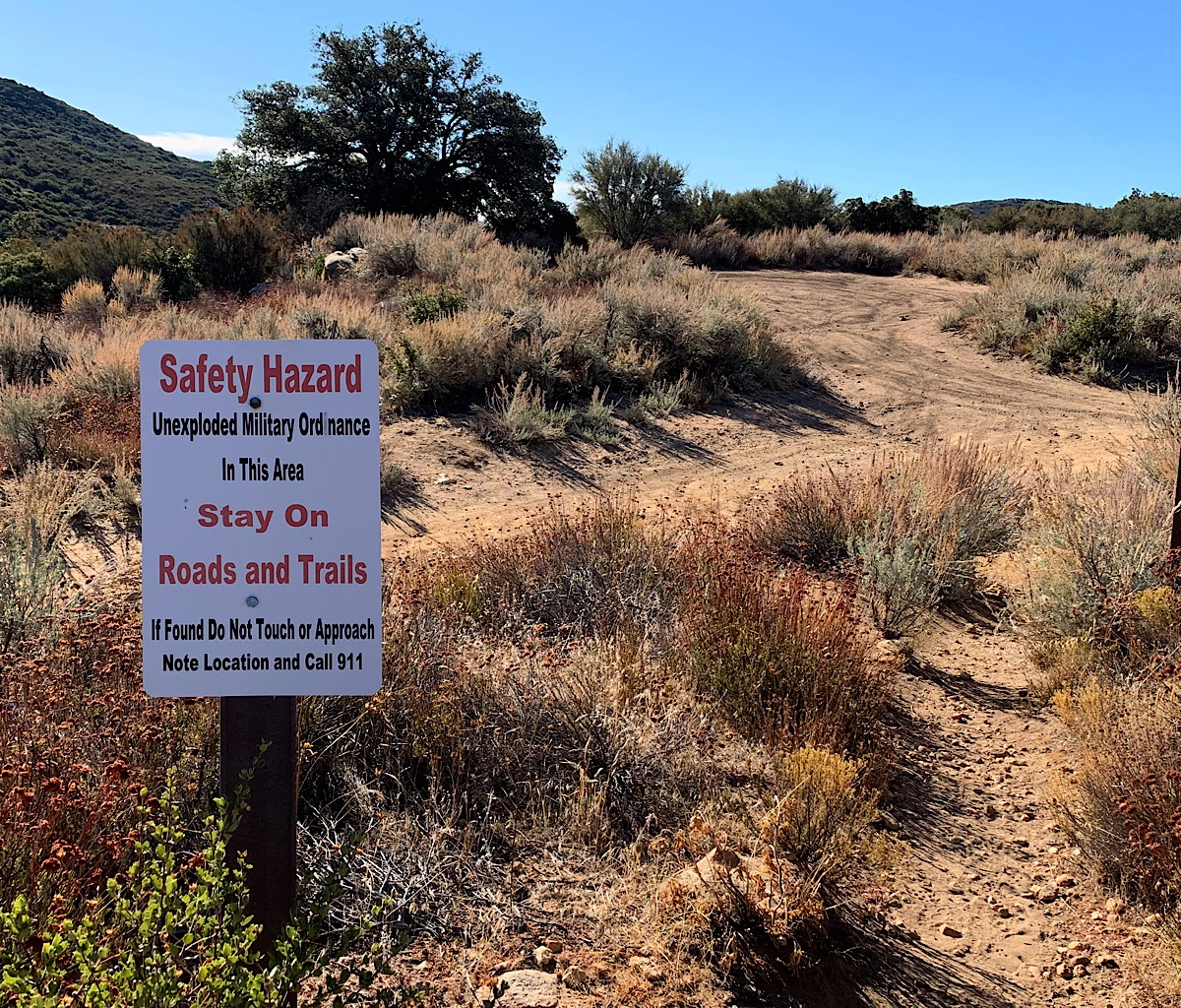 The PCT enters a hazard zone of unexploded ordinance and i happily stay on the path.