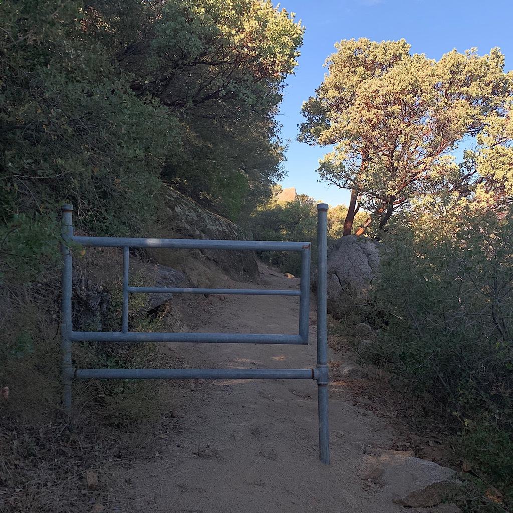 A pipe gate in the desert.