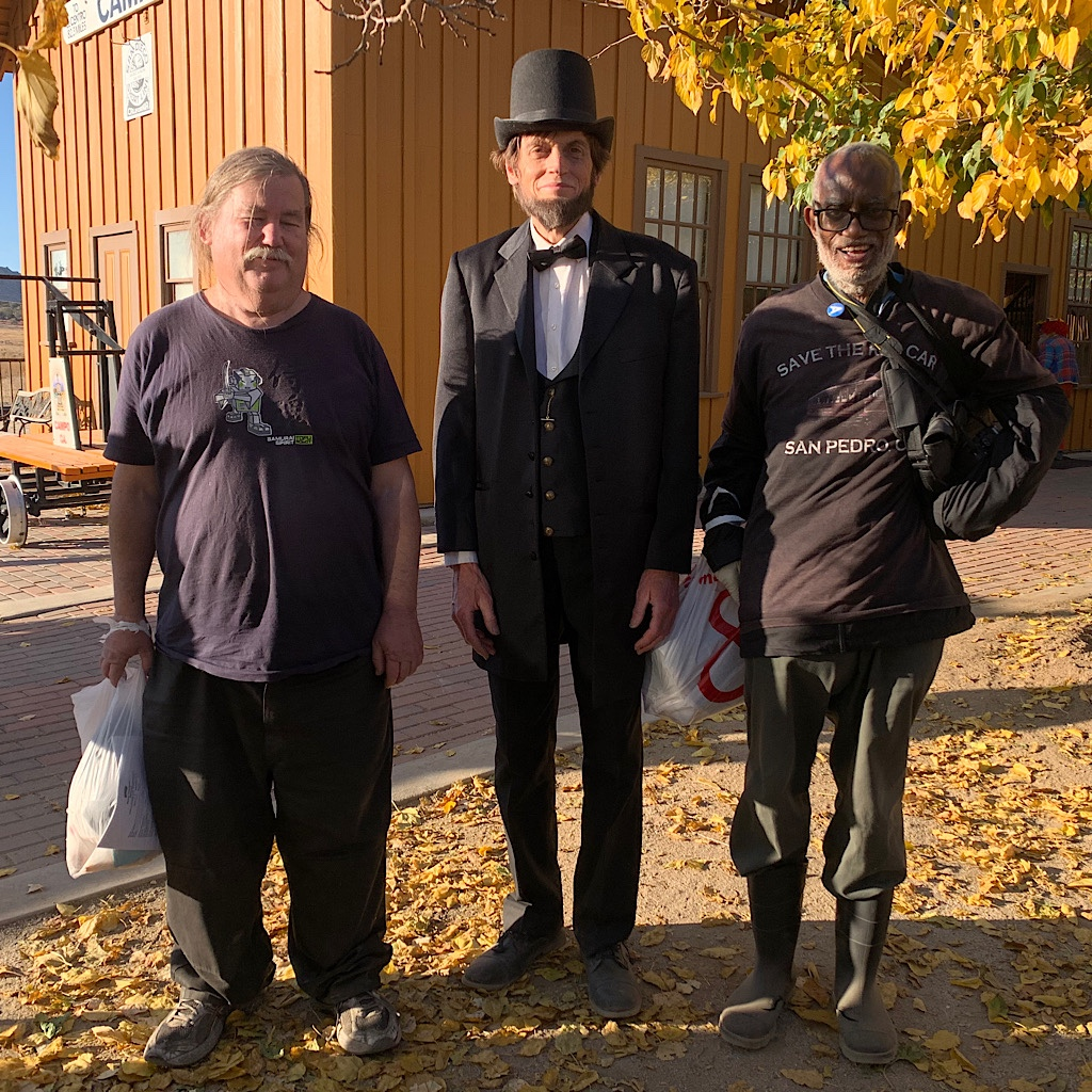 A Lincoln impersonator and friends at the Camp train depot.
