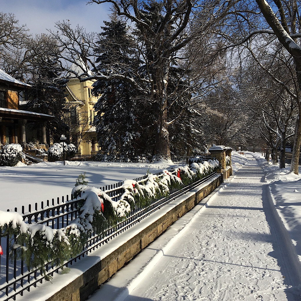 Snowy Summit Avenue in Saint Paul in  bright sun.