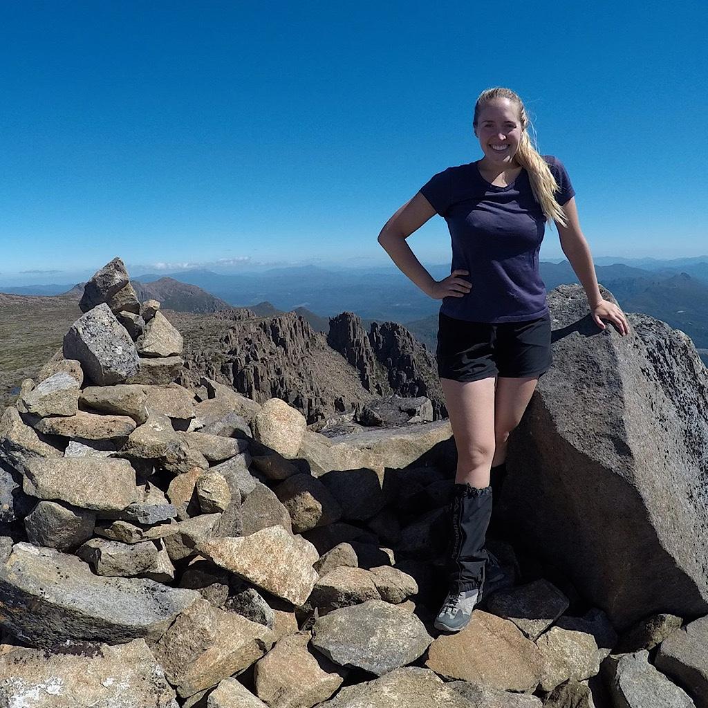 Emily Granger atop a summit in Tasmania.