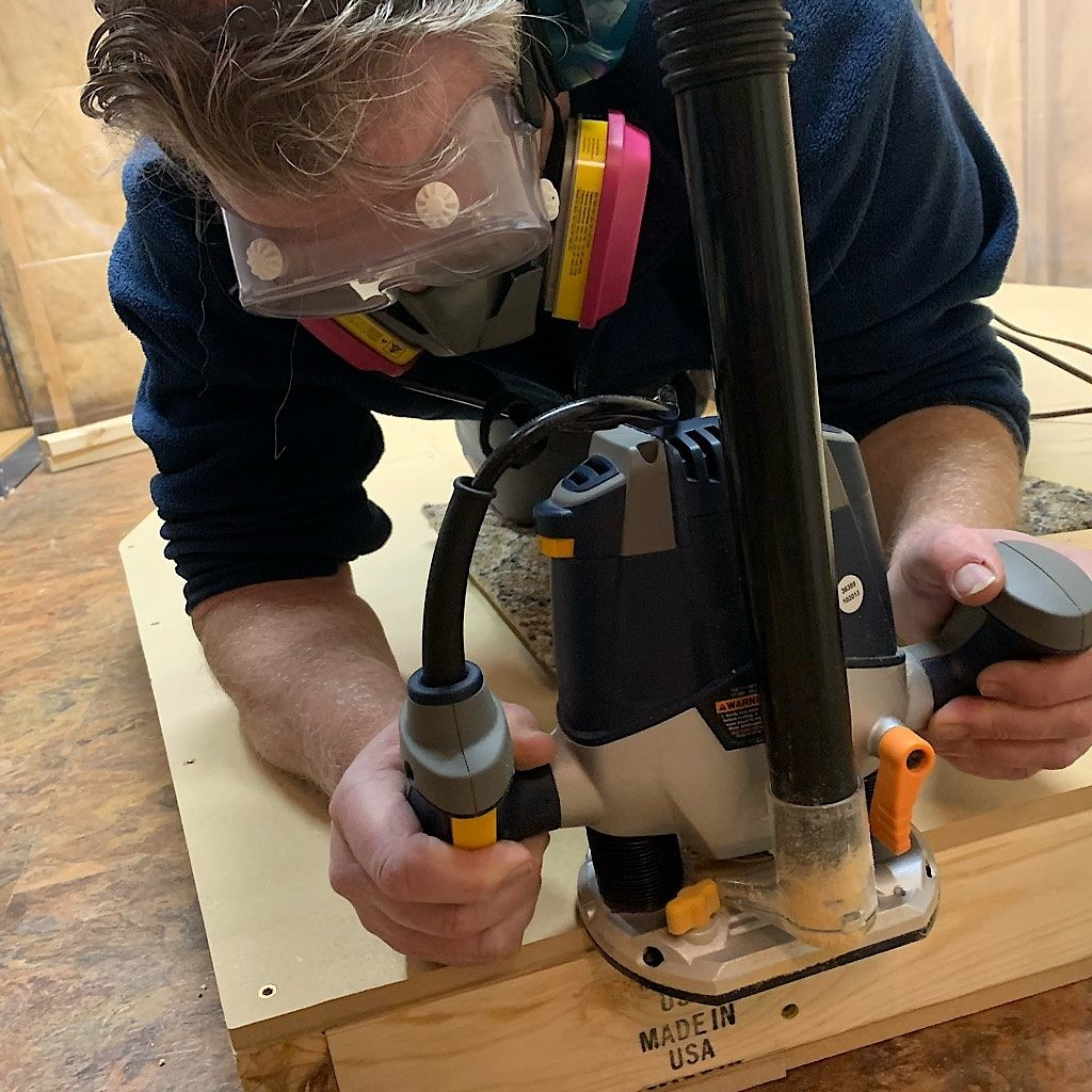 Richard uses a router to smooth the edges and hide mistakes.