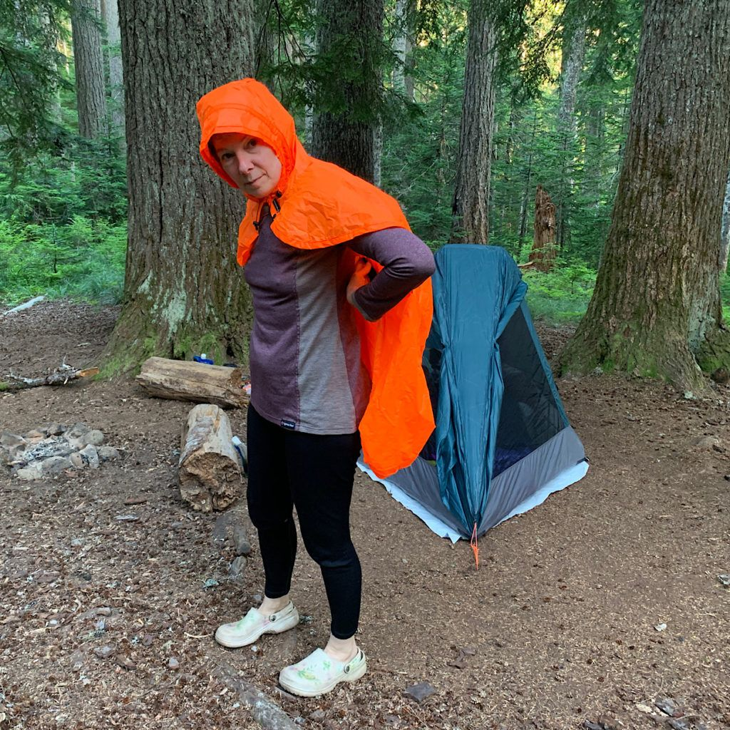 Judy Gross of Light Heart Gear demonstrating her hooded poncho/cape, about all a backpacker really needs.