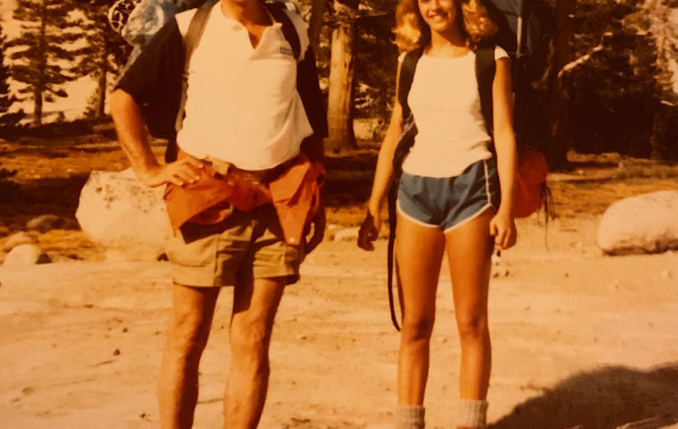 At 50 and 15, dad and I backpacked in Yosemite National Park, but why are we standing behind a rock, I wonder?