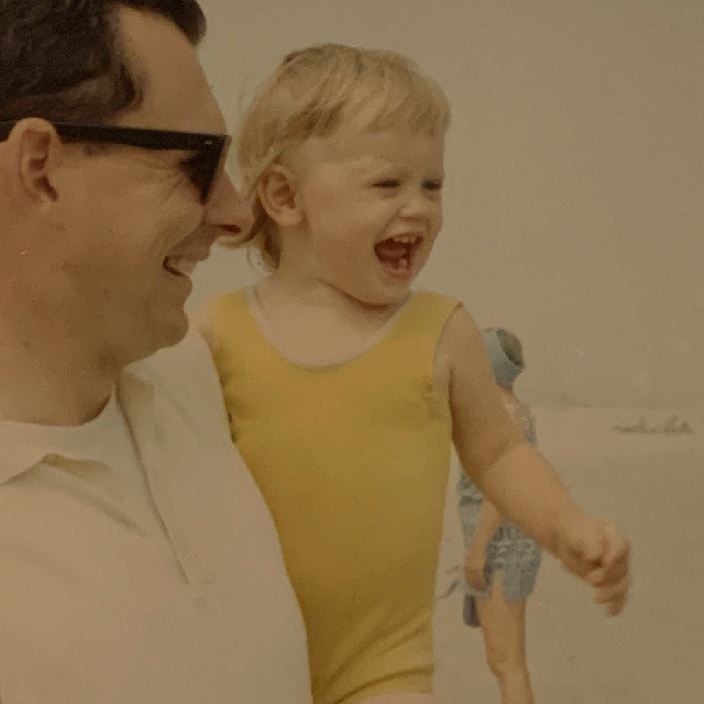 I inherited my dad's nose, crinkly eyes and huge, no-holds-barred smile.