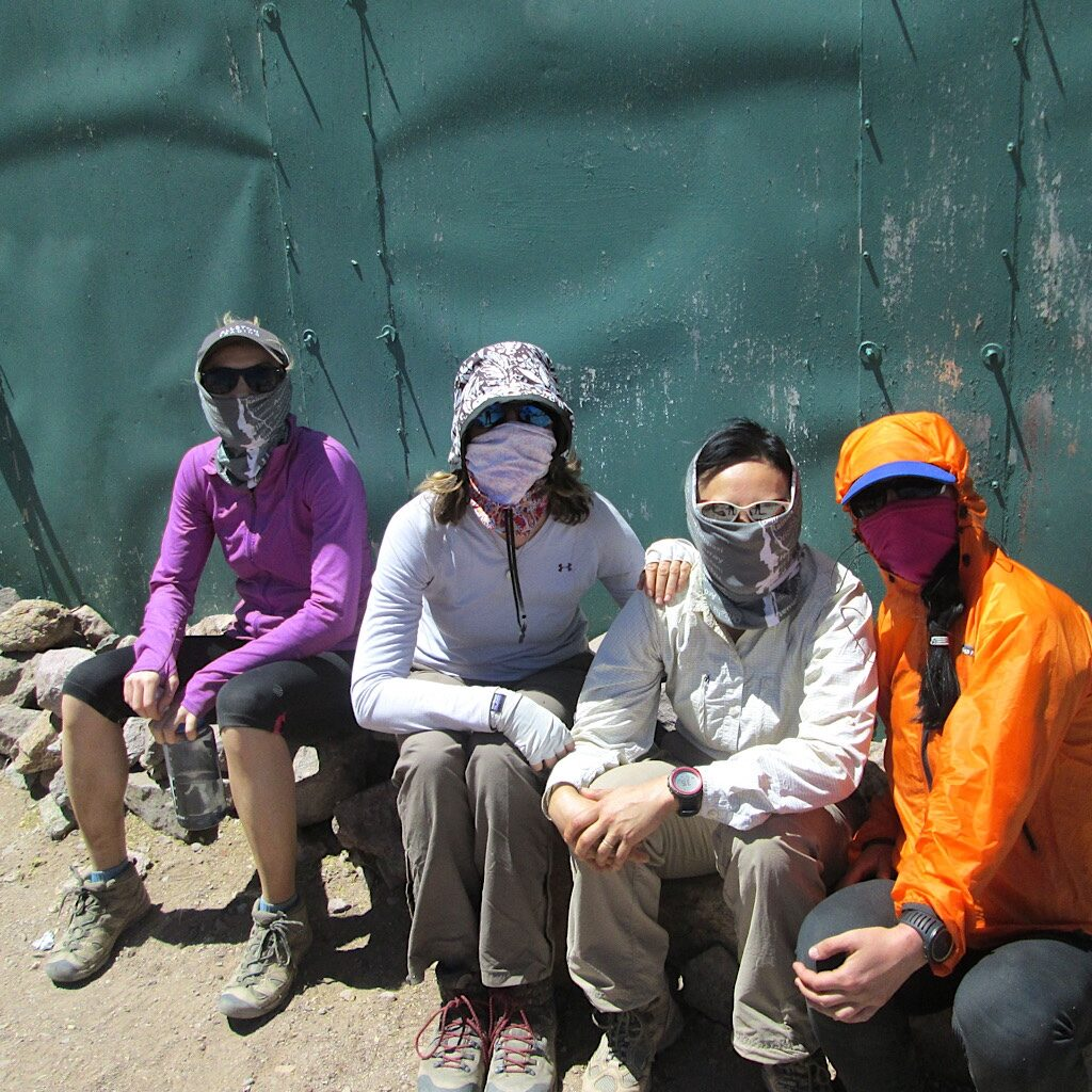 "The ""chicks"" of the expedition protecting ourselves from blowing dust at base camp."