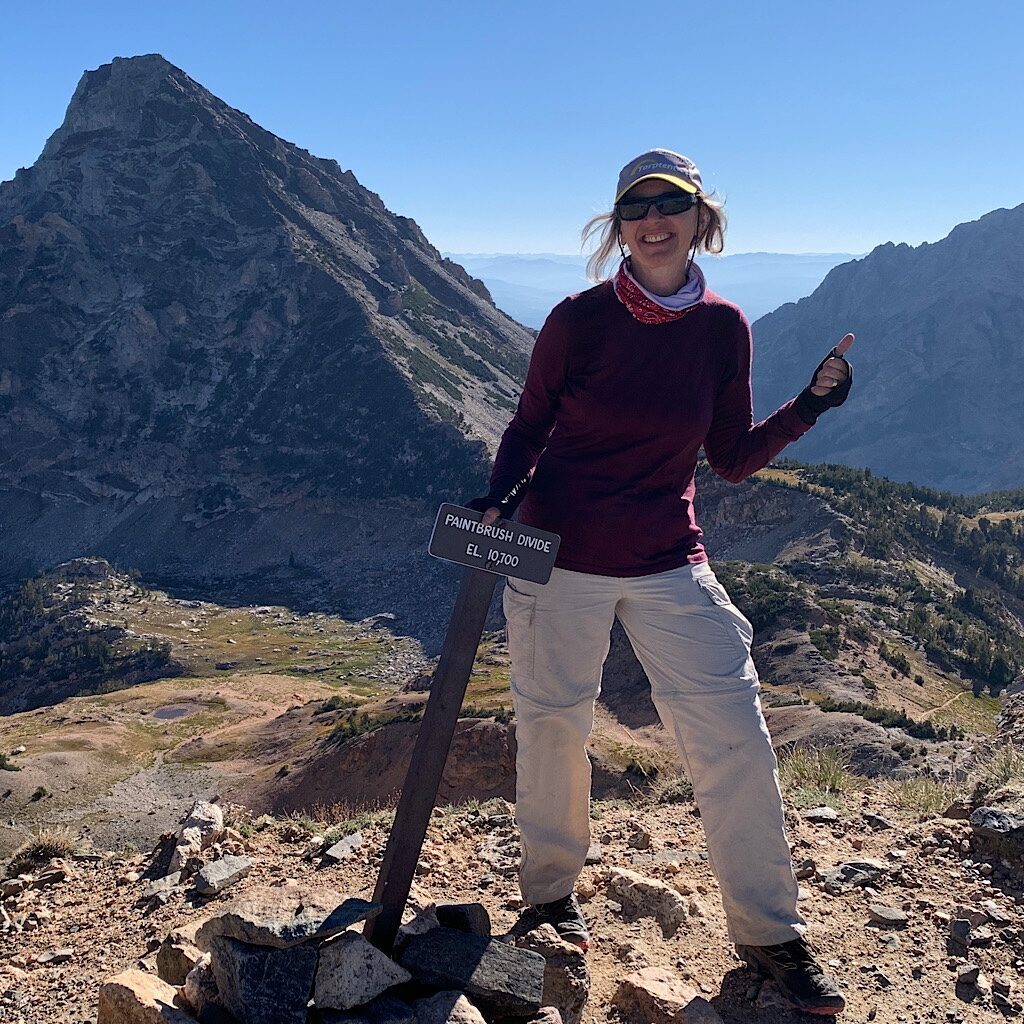 Feeling strong with Grizzly Lake just below and the Wind River Range in the distance.