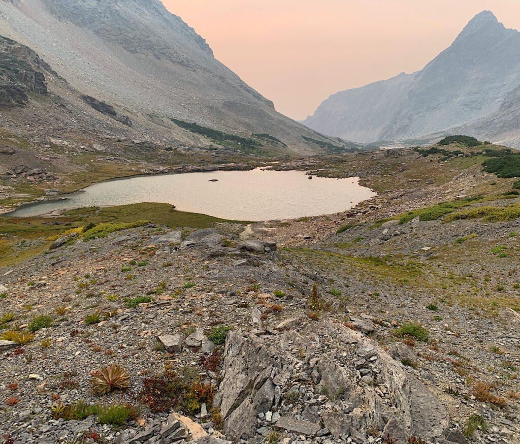 Kit Lake lies below the trail about 250 feet.