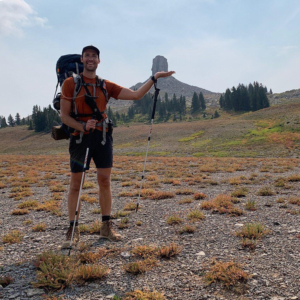 A fellow solo hiker palming Spearhead Peak.